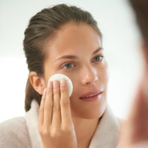 woman-wiping-cotton-pad-over-cheek_1