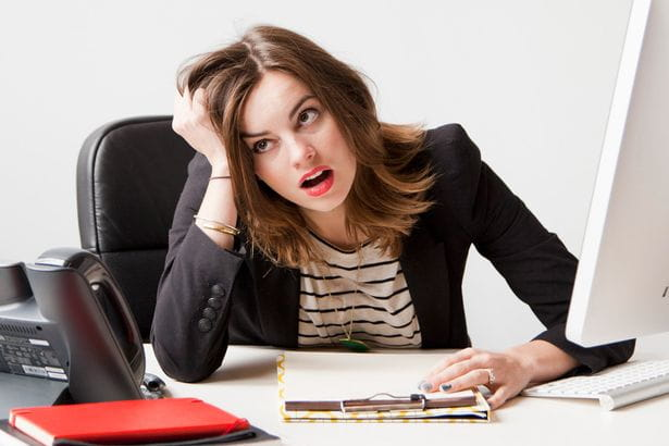 Woman-working-in-office-being-under-emotional-stress