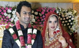 India's tennis player Sania Mirza (R) and Pakistani cricketer Shoaib Malik smile during their wedding ceremony at a hotel in the southern Indian city of Hyderabad April 12, 2010. Sania married Shoaib on Monday, after a romance that saw the groom forced to get a messy divorce from his first wife days before the wedding. REUTERS/Handout (INDIA - Tags: SPORT CRICKET SOCIETY TENNIS IMAGES OF THE DAY) FOR EDITORIAL USE ONLY. NOT FOR SALE FOR MARKETING OR ADVERTISING CAMPAIGNS